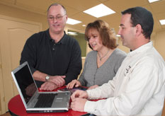 a couple and salesmen using Basement Vision software