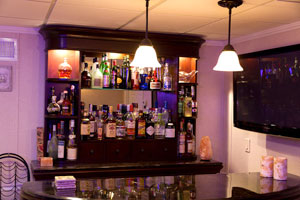 A basement bar installed in a finished basement in Marlton