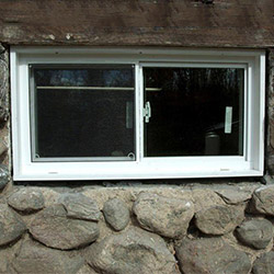 An energy efficient double-paned window installed in a basement in Williamstown.