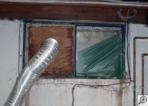 A basement window system that's rotted and  has been damaged over time in Sewell.